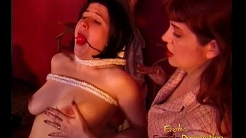 Busty raven-haired harlot enjoys letting a redhead slag birch her hard