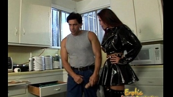 Latex-clad raven-haired harlot bangs her extremely horny repairman with regard to the kitchen
