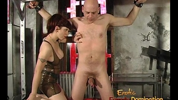 Stark naked stud enjoys being pleasured wide of a busty redhead in the dungeon