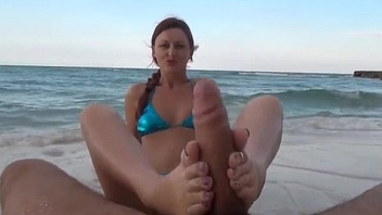 Footjob on the beach