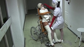 Patient in Wheelchair with Broken Frontier fingers and Straitjacket - TheWhiteWard.com
