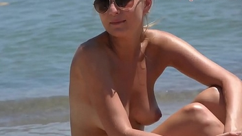 Gorgeous flaxen-haired Topless on the Beach